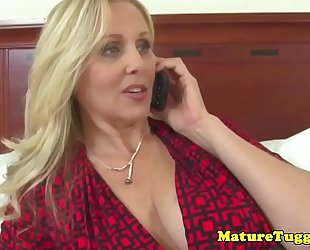 Bigtitted milf jerking on pecker