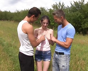 Skinny amateur girl serves two horny stallions in the field