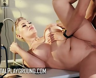 Short-haired woman with big tits gets banged on the table