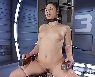 Brunette in servitude fucking machine